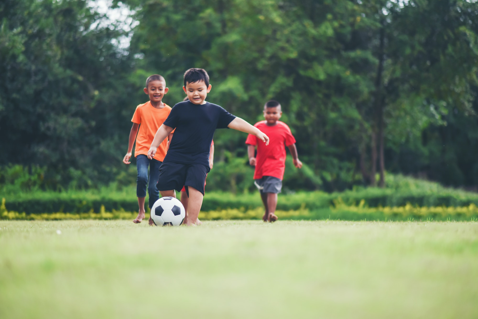 Kids playing soccer football